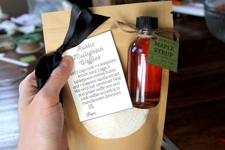 gluing tags and syrups onto waffle mix bags