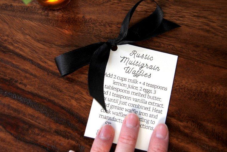 tying ribbon into instruction gift tag