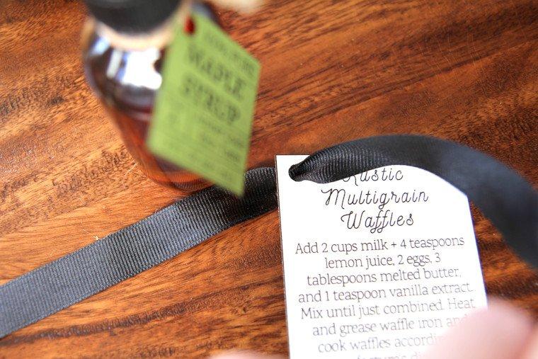 tying ribbon onto instruction gift tag