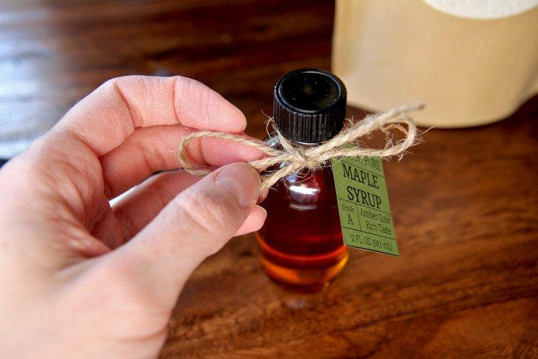 tying twine onto syrup bottle