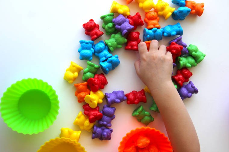 toddler playing with counting bears