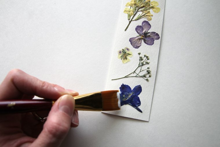 applying Mod Podge over tops of flowers