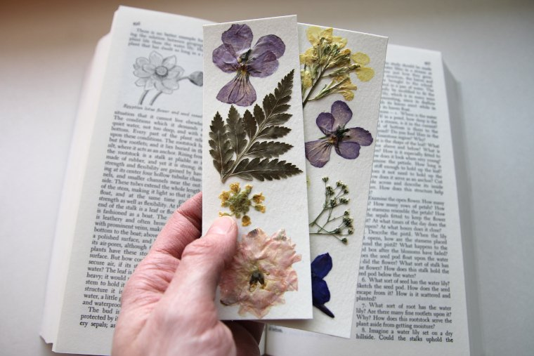 two finished bookmarks with book