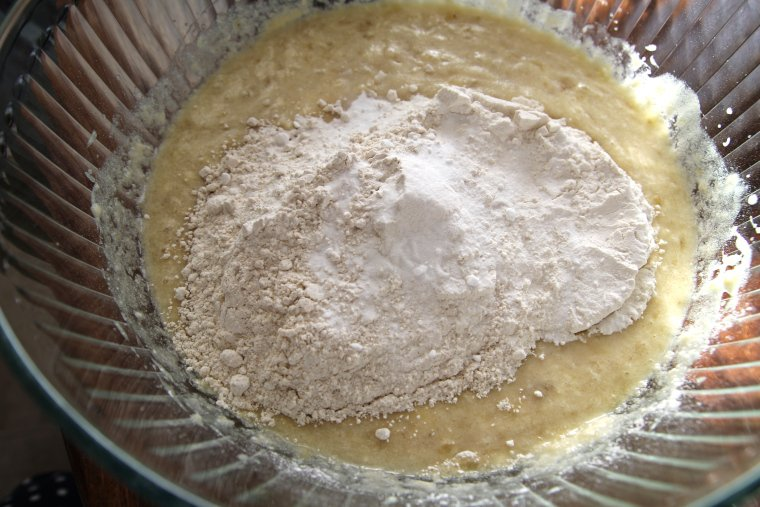 adding flours, salt, and baking soda
