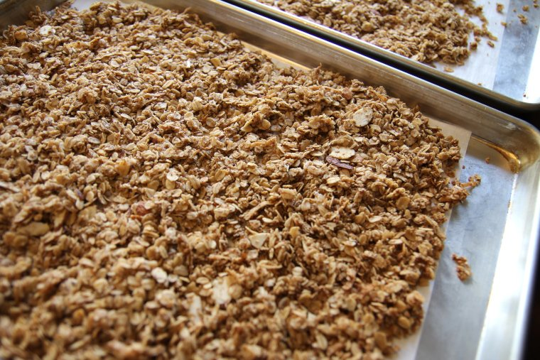 granola cooling on pans