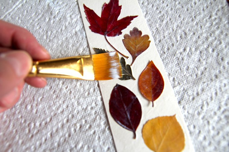 apply Mod Podge to entire surface and smooth brush strokes