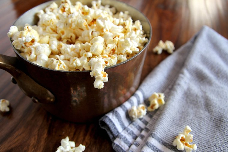 side view of kettle corn popcorn in a copper pan