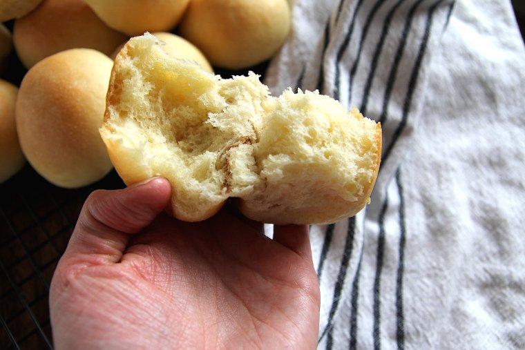 a sourdough potato roll torn in half