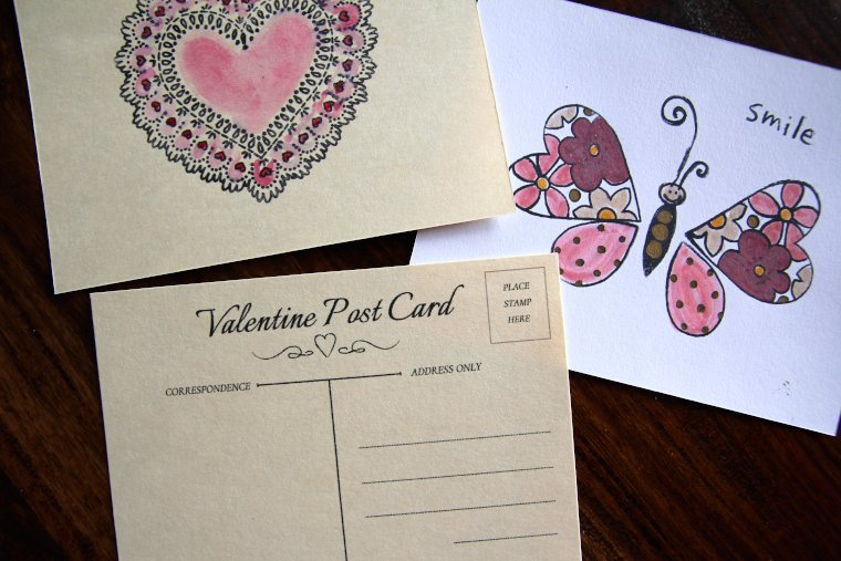 Valentine postcards on table