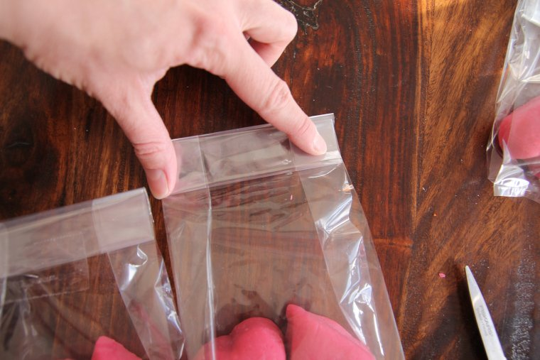 fold top of treat bag down over itself two or three times and tape into place