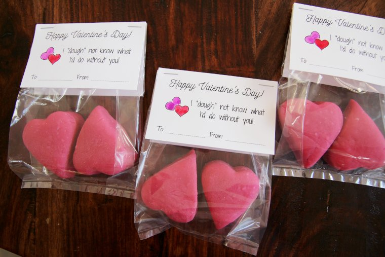punny playdough valentines sitting on a table