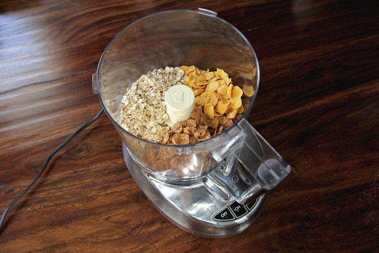 add oats and cereals to the bowl of a food processor