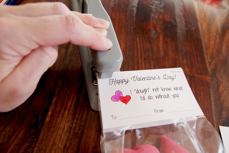 place valentine over treat bag and staple into place in the top two corners