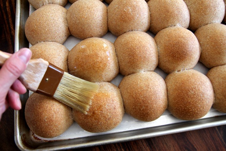 brush warm rolls with melted butter