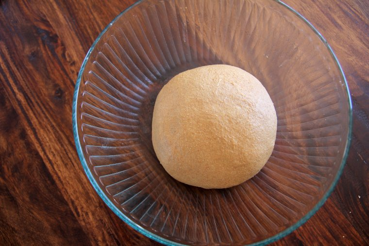 place dough in oiled bowl