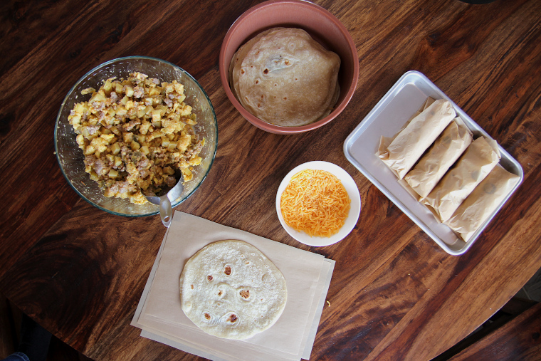 breakfast burrito filling station at kitchen table