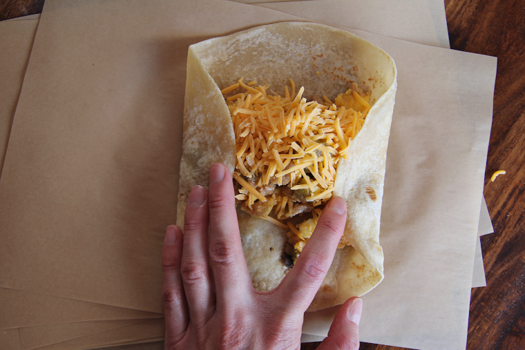 folding in the sides of the breakfast burrito