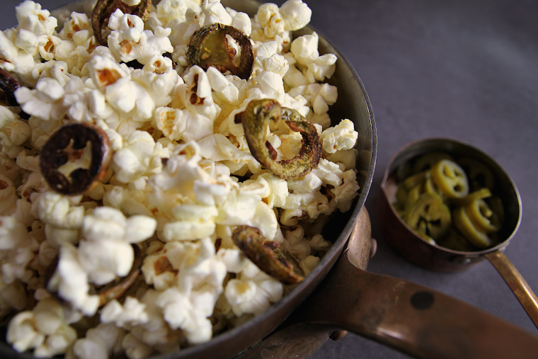 jalapeno popcorn in copper sauce pan close up