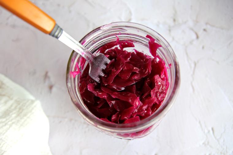 purple sauerkraut in a jar with a fork