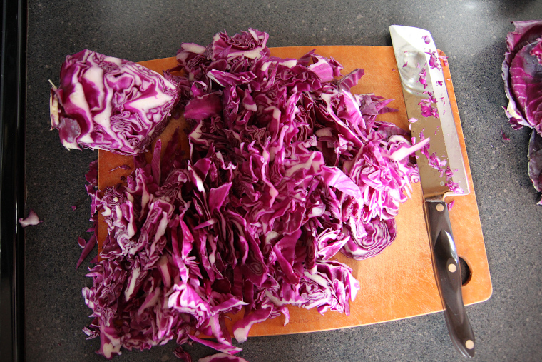 red cabbage on a cutting board after slicing thinly