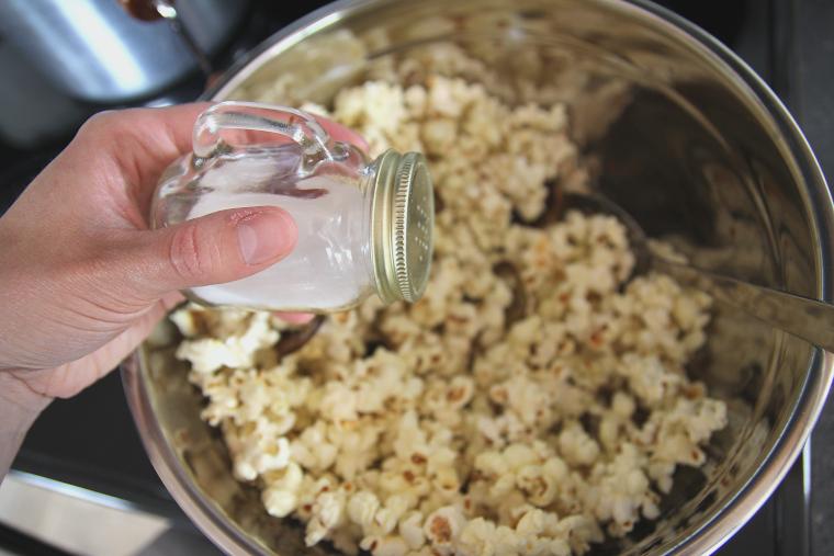salting popcorn