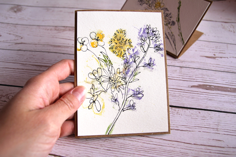 hand holding finished nature craft card