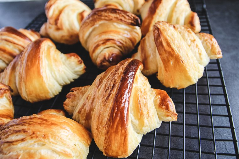 croissants up close on a cooling rack