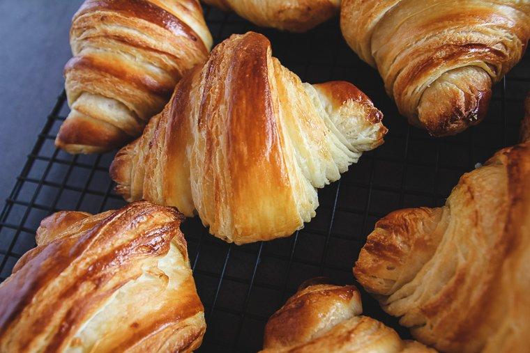 sourdough croissants up close on a cooling rack