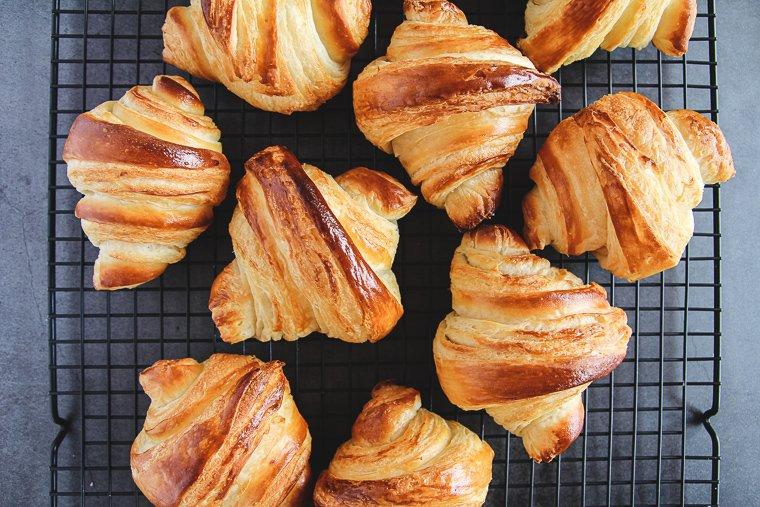 sourdough croissants on a cooling rack