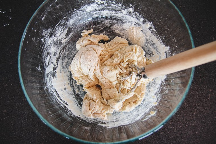 stirring dough ingredients with a Danish dough whisk
