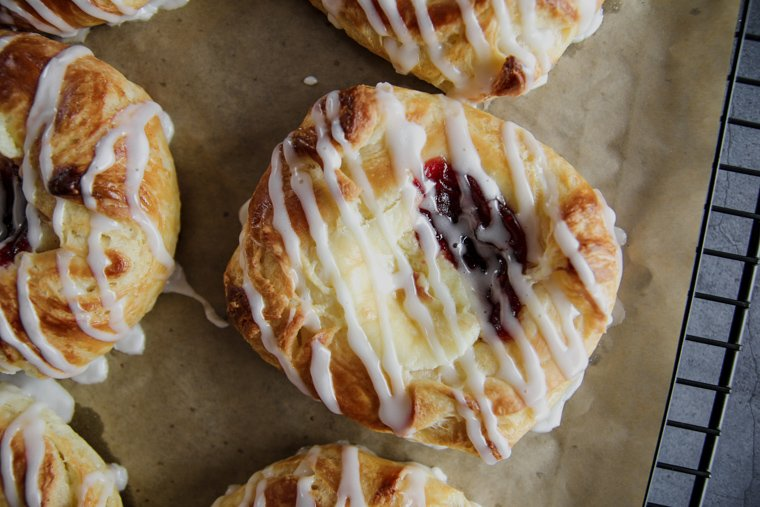 a homemade danish pastry close up on a cooling rack with parchment paper