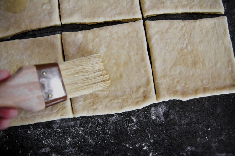 brushing the center of each square with egg wash