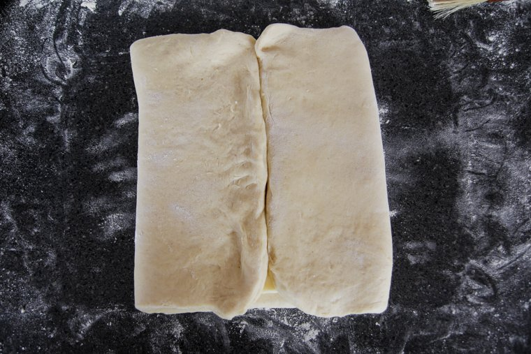 Dough ends meeting in the center of the butter block.