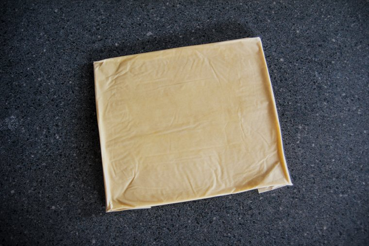 butter pressed into the parchment paper rectangle - the finished butter block