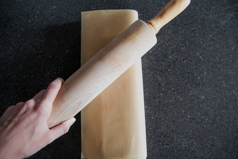 pounding butter with rolling pin