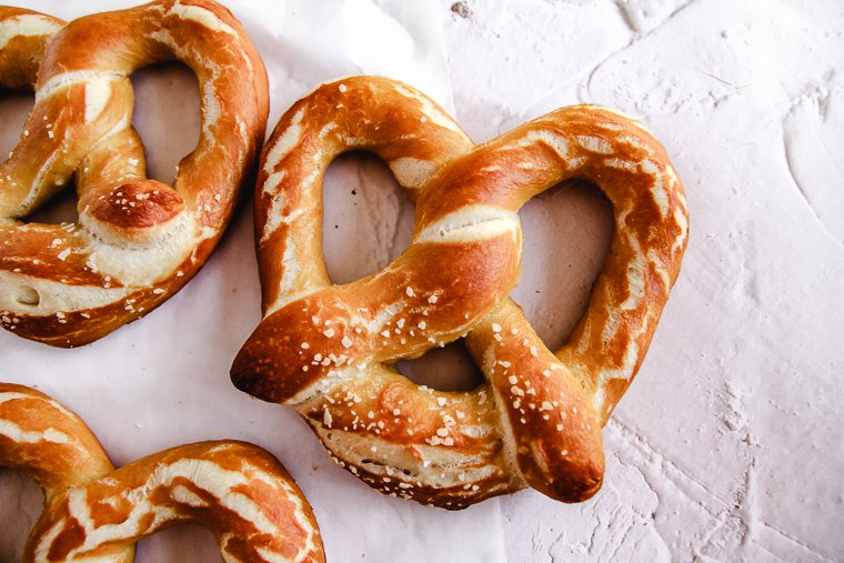 a close up shot of a salted sourdough soft pretzel