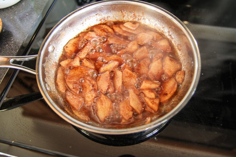 the apple topping after the apples are tender and the syrup has reduced